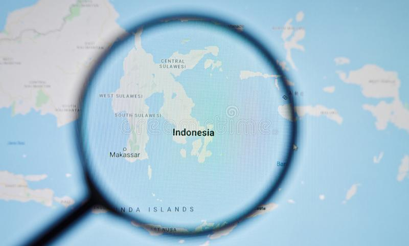 UKRAINE, ODESSA - APRIL 25, 2019: Indonesia on google maps through magnifying glass. UKRAINE, ODESSA - APRIL 25, 2019: Indonesia on google maps through royalty free stock images