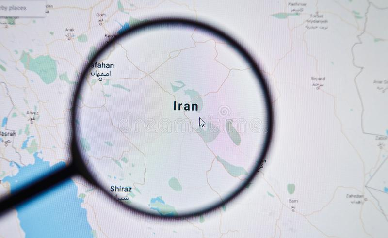UKRAINE, ODESSA - APRIL 25, 2019: Iran on google maps through magnifying glass. UKRAINE, ODESSA - APRIL 25, 2019: Iran on google maps through magnifying glass stock photos