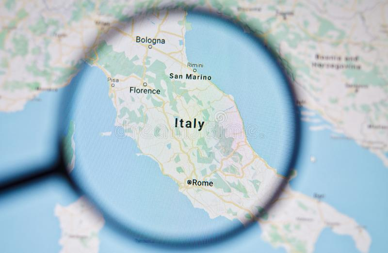 UKRAINE, ODESSA - APRIL 25, 2019: Italy on google maps through magnifying glass. UKRAINE, ODESSA - APRIL 25, 2019: Italy on google maps through magnifying glass royalty free stock photo