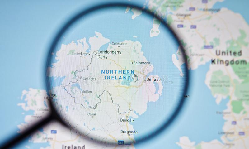 UKRAINE, ODESSA - APRIL 25, 2019: Northern Ireland on google maps through magnifying glass. UKRAINE, ODESSA - APRIL 25, 2019: Northern Ireland on google maps royalty free stock photos
