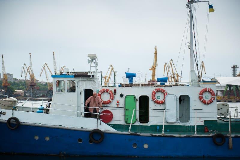 Ukraine, Odessa - 01 april 2013: Old man on the boat. stock photo