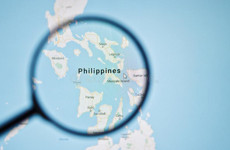 UKRAINE, ODESSA - APRIL 25, 2019: Philippines on google maps through magnifying glass. UKRAINE, ODESSA - APRIL 25, 2019: Philippines on google maps through stock image