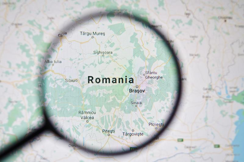 UKRAINE, ODESSA - APRIL 25, 2019: Romania on google maps through magnifying glass. UKRAINE, ODESSA - APRIL 25, 2019: Romania on google maps through magnifying stock photo