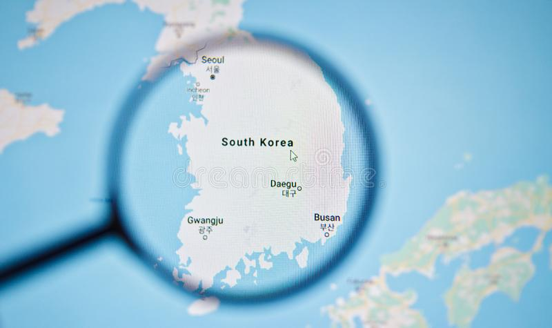 UKRAINE, ODESSA - APRIL 25, 2019: South Korea on google maps through magnifying glass. UKRAINE, ODESSA - APRIL 25, 2019: South Korea on google maps through royalty free stock images