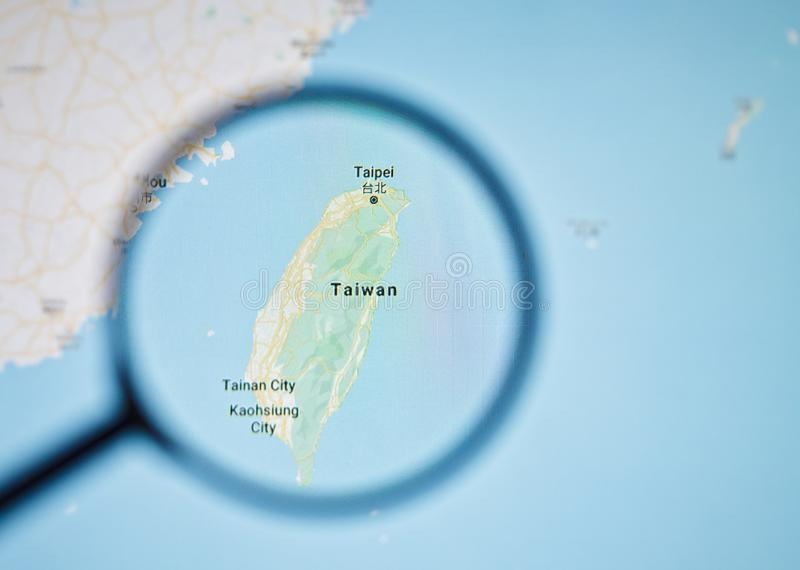 UKRAINE, ODESSA - APRIL 25, 2019: Taiwan on google maps through magnifying glass. UKRAINE, ODESSA - APRIL 25, 2019: Taiwan on google maps through magnifying royalty free stock photography