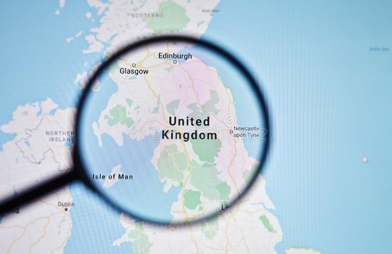 UKRAINE, ODESSA - APRIL 25, 2019: United Kingdom on google maps through magnifying glass. UKRAINE, ODESSA - APRIL 25, 2019: United Kingdom on google maps stock photo