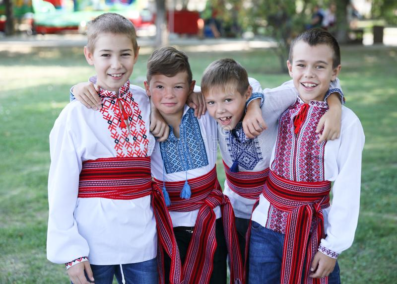 Ukraine, Pokrov - August 23, 2019: National Flag Day Celebration. Four young boys friends dressed in folk Ukrainian embroidered royalty free stock images