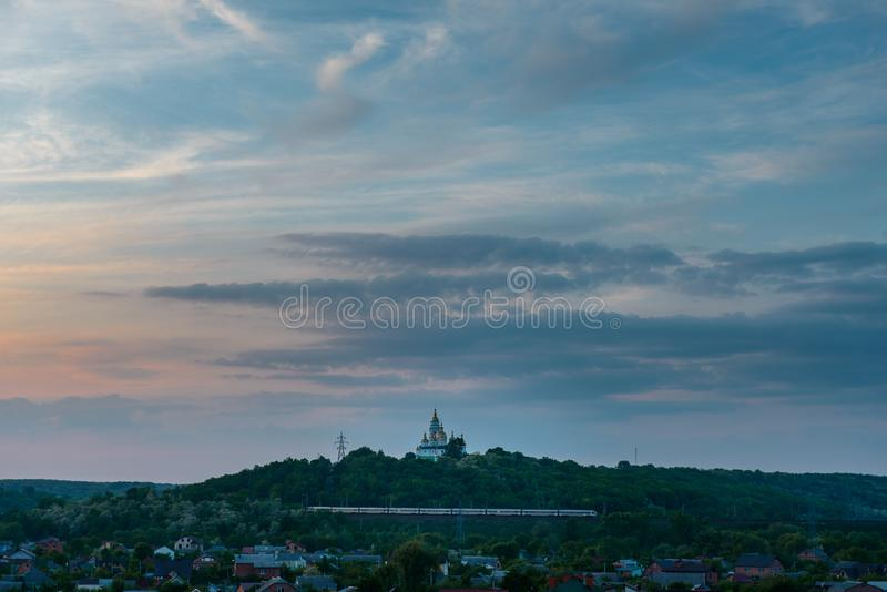 Ukraine Poltava city scenery church clouds blue sky and houses royalty free stock photography