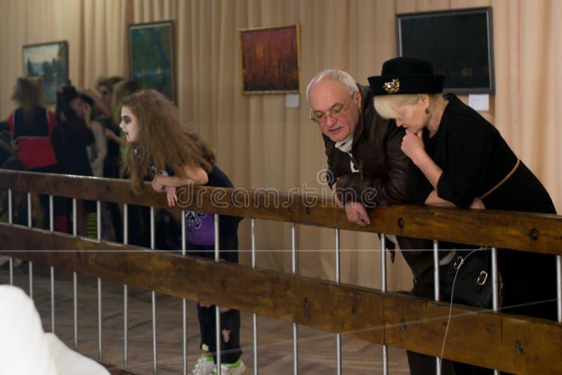 Ukraine,Shostka, Art Center, Mira street -December 15, 2017: Mature couple and girl teenager at an art exhibition royalty free stock image