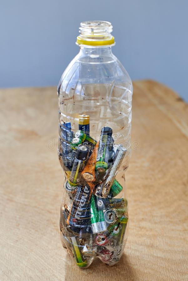 Ukraine, Shostka -March 20, 2019: Used batteries in a plastic bottle, the topic of sorting garbage stock photography