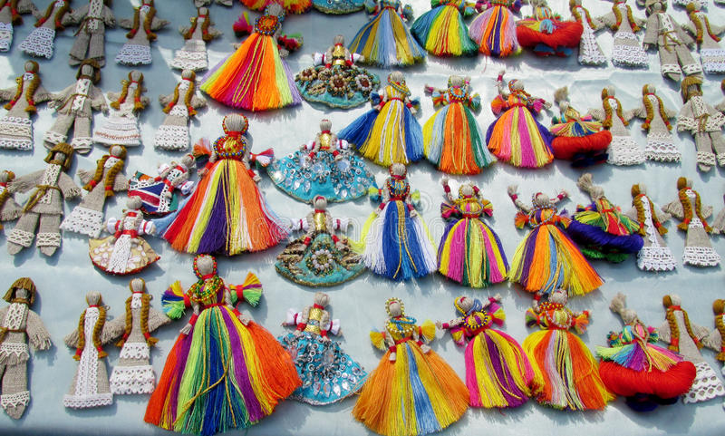Ukraine traditional thread dolls. Souvenirs sold on the street in Andreevsky spusk in Kiev, Ukraine. Traditional arts, ukrainian clothes and paintings stock photography