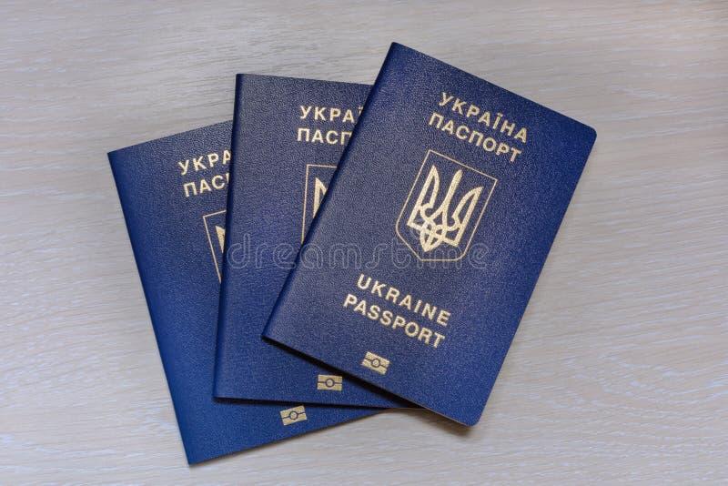 Ukrainian biometric passport on a grey background royalty free stock photo