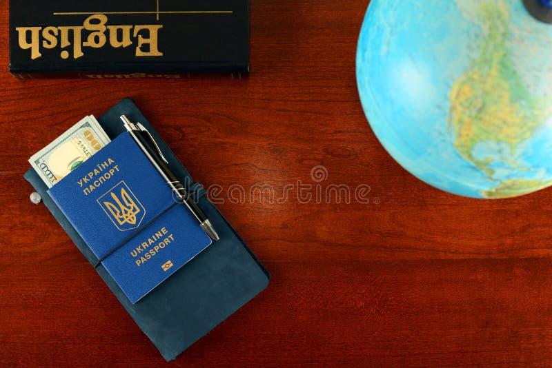 Ukrainian biometric passport. Learning English for business trip royalty free stock photo