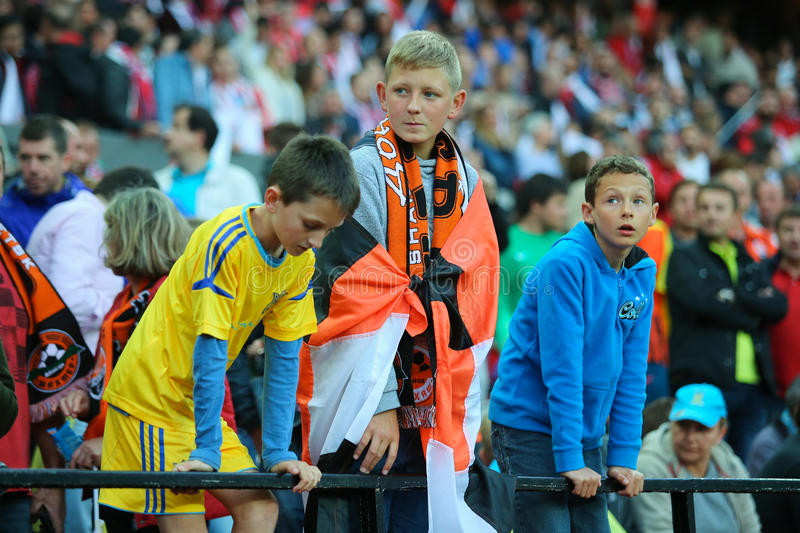 Ukrainian boys fans staying on the stands stock photos