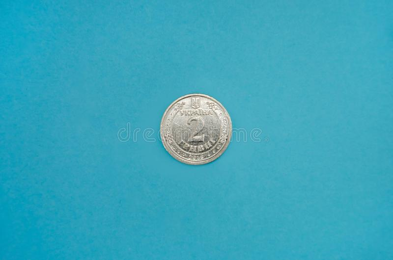 Ukrainian coin, face value of 2 hryvnia on a blue background. View from above. stock photos