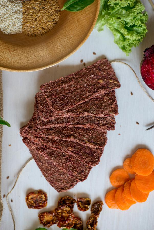 Ukrainian Crispbread  with beetroot and tomato. Healthy diet food. Bread cakes on a white background in the ingredient seasoning.  stock images