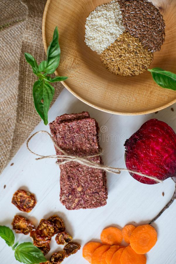 Ukrainian Crispbread  with beetroot and tomato. Healthy diet food. Bread cakes on a white background in the ingredient seasoning.  stock photo