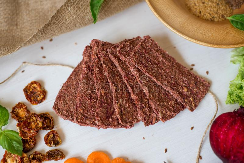 Ukrainian Crispbread  with beetroot and tomato. Healthy diet food. Bread cakes on a white background in the ingredient seasoning.  royalty free stock photo