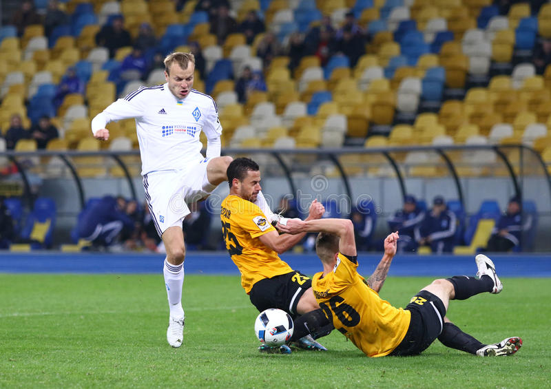 Ukrainian Cup quarterfinal game FC Oleksandria vs FC Dynamo Kyiv in Kyiv, Ukraine. KYIV, UKRAINE - March 1, 2016: Oleh Gusev (in White) kicks the ball during royalty free stock photography