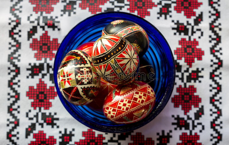 Ukrainian Easter Eggs. In a blue bowl on a tradition cloth royalty free stock images