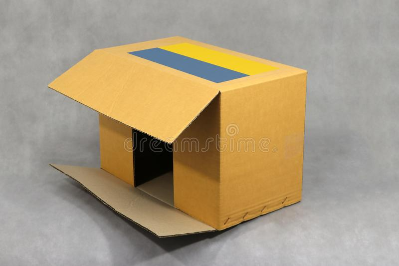 Ukrainian flag on brown carton box, Paper packaging for put products. The concept of Ukraine export trading. Ukrainian flag on brown carton box, Paper packaging royalty free stock image