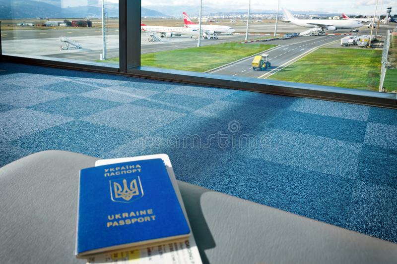 Ukrainian foreign passport with tickets is on chair at the airport. stock photography