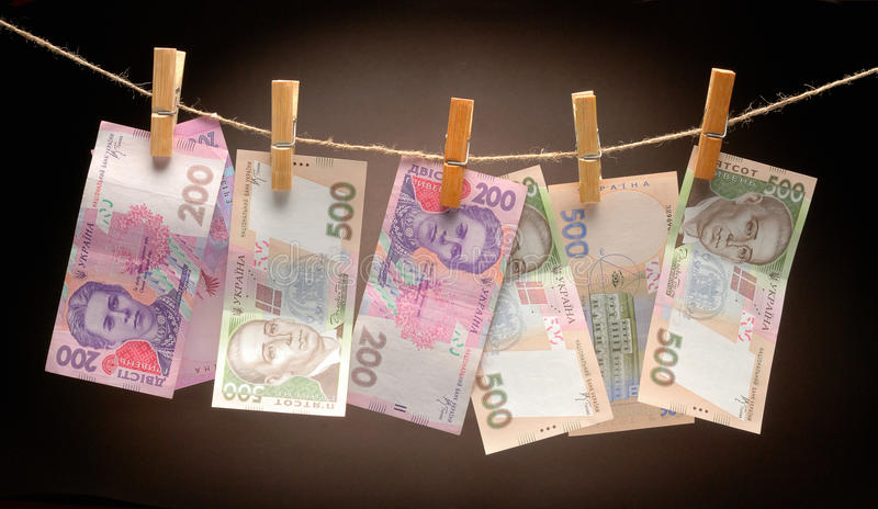 Ukrainian grivna notes on Rope with Clothespins royalty free stock photo