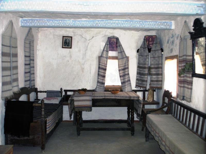 Ukrainian historical peasant dwelling interior with various home articles stock photography