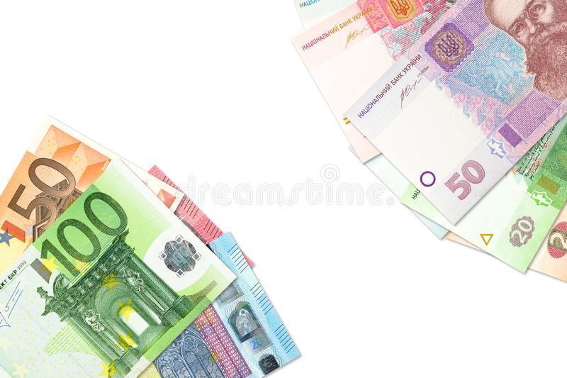 Some ukrainian hryvnia banknotes and euro banknotes indicating bilateral economic relations with copyspace. Ukrainian hryvnia banknotes and euro banknotes royalty free stock images