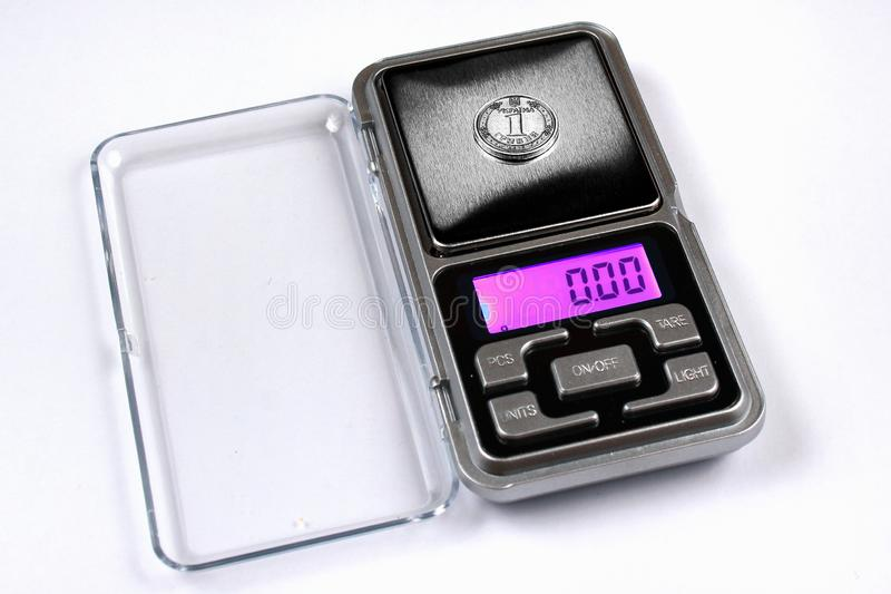 Ukrainian hryvnia coin on scales, shows zero weight. stock photo
