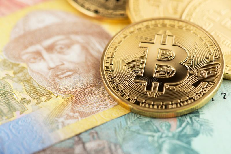 Bitcoin and Ukraine national currency. Bitcoins with Ukraine money hryvnya. stock images