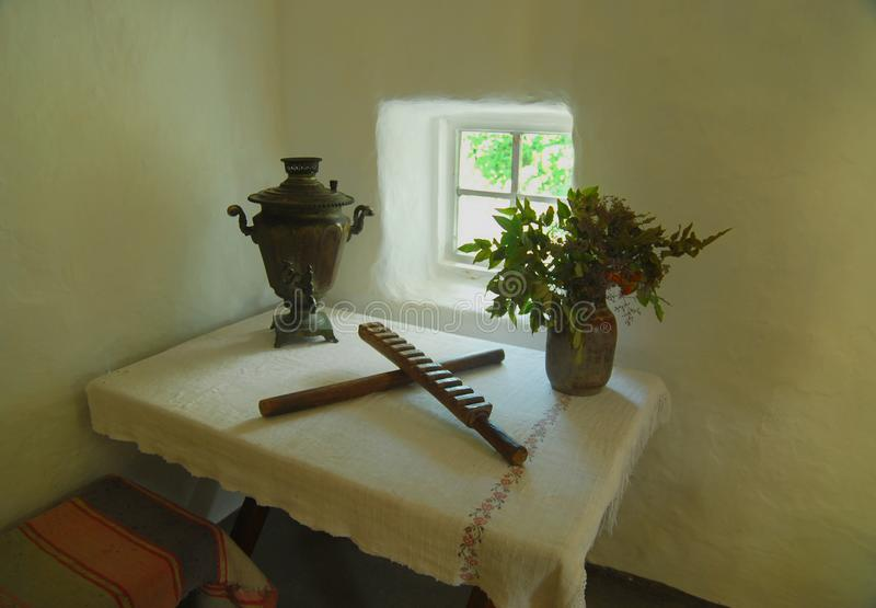 Ukrainian like peasant dwelling interior with various home articles. Museum royalty free stock images