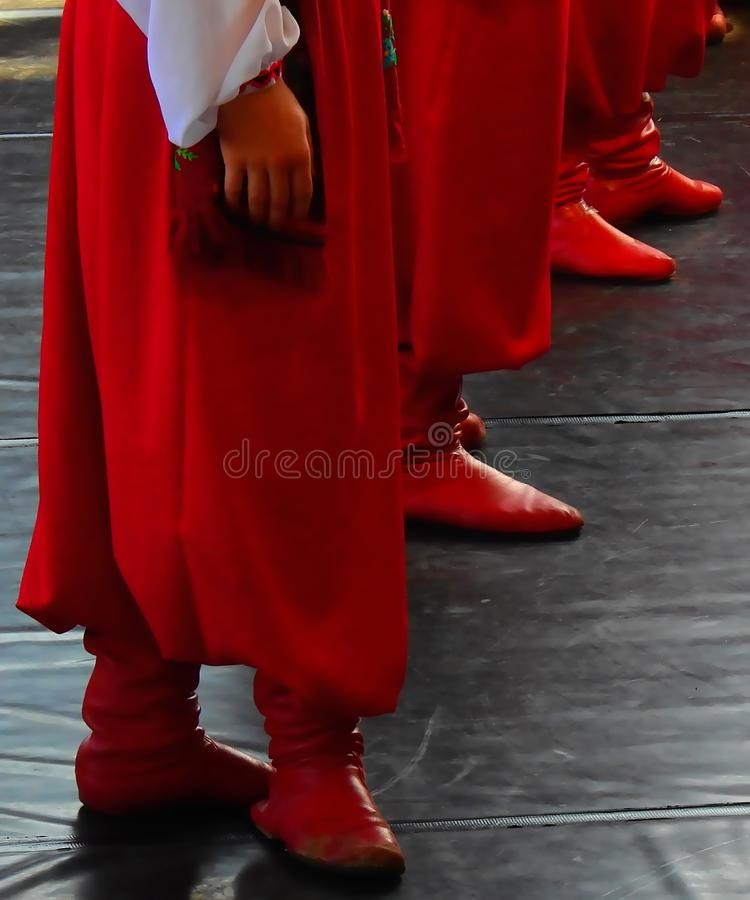 Ukrainian men dancing - red boots and sharovary pants. Ukrainian dance is often described as energetic, fast-paced, and entertaining, and highly appreciated stock image