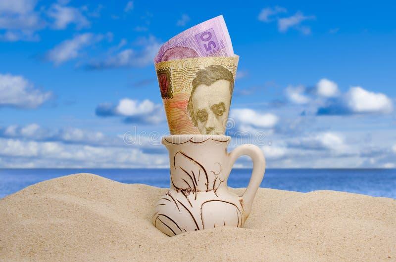 Ukrainian money on a beach stock photos