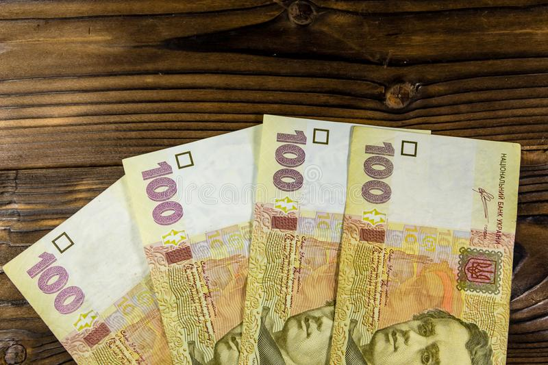 Ukrainian money hryvnia nominal value of one hundred. On wooden background royalty free stock photography