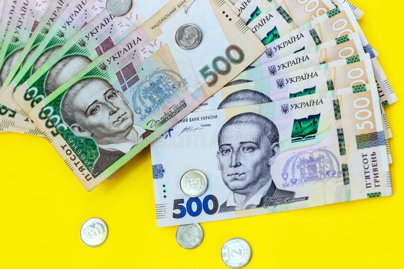 Ukrainian money hryvnia and a penny. New and old bills in 500 UAH. Ukrainian money hryvnia and a penny. New and old bills in 500 UAH stock photo