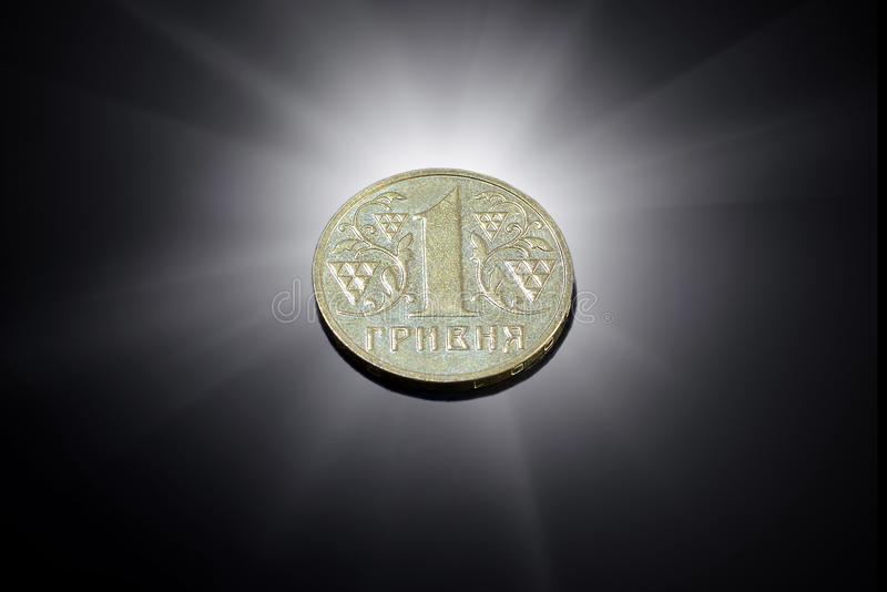 Ukrainian one hryvnia coin on a black background royalty free stock images