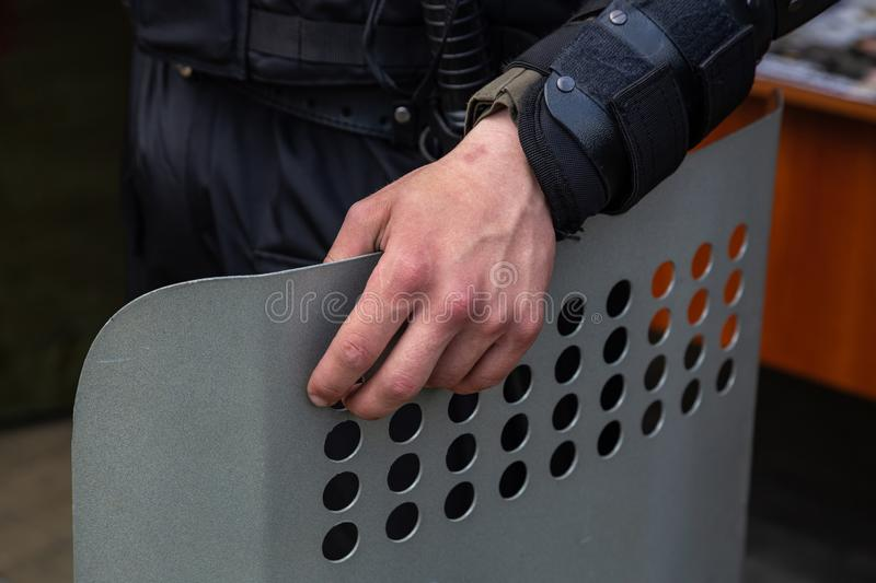Ukrainian police officer with a metal shield at the protest stock photos