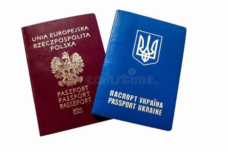 Ukrainian and Polish passport. On a white background stock photos