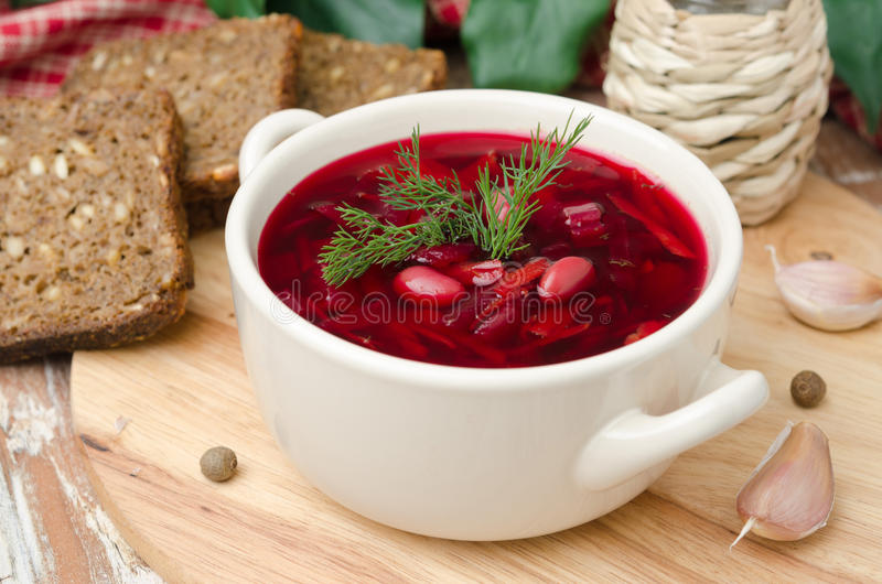 Ukrainian and russian national red borsch with herbs horizontal. Ukrainian and russian national red borsch with herbs on a wooden board horizontal stock photography