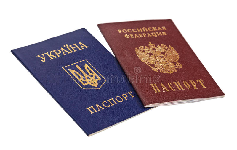 Ukrainian and Russian passports. Isolated on white background royalty free stock photography