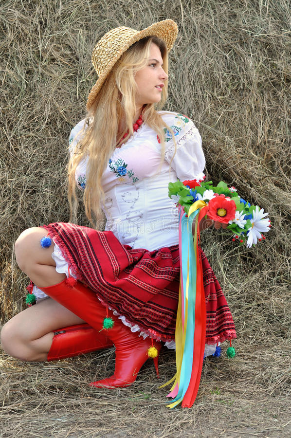 Ukrainian teenage girl in traditional clothes. Near the haystack royalty free stock photo