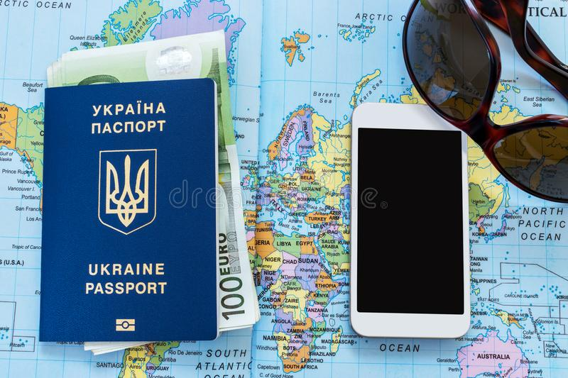 Ukrainian travel passport on a world map stock image image of ukrainian travel passport on a world map euro banknotes sunglasses and mobile phone on the background eu visa free access publicscrutiny Choice Image