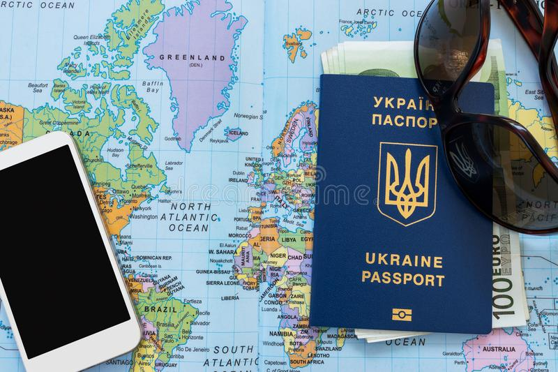 Ukrainian travel passport on a world map stock photo image of ukrainian travel passport on a world map euro banknotes sunglasses and mobile phone on the background eu visa free access gumiabroncs