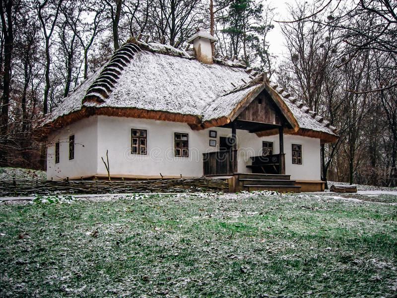 Ukrainian village hut with thatched roof stock image