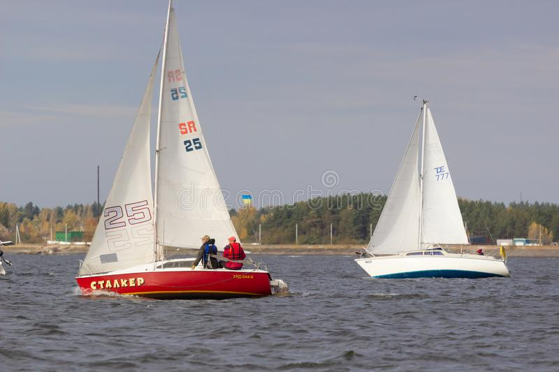 UKRAINKA, UKRAINE - OCTOBER 12, 2019: Racing sailing boats during a regatta. South worth near Kiev on October 12, 2019 stock image