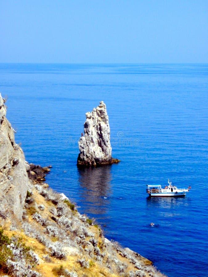 Ukranian black sea coast with ship and rock. A ship and a rock at the ukrainian black sea coast stock image
