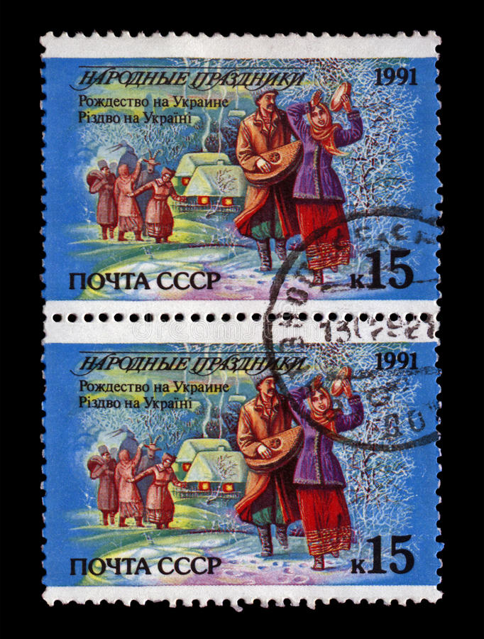 Ukranian people dancing during Christmas holiday, tree under snow, Happy New Year, Ukraine, circa 1991, royalty free stock photo