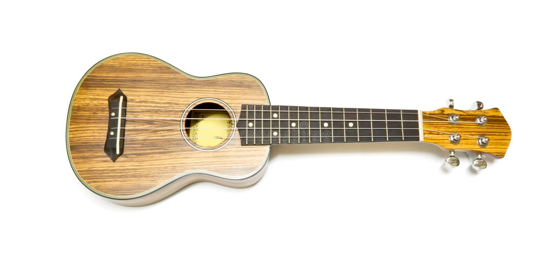 Ukulélé, instrument de musique de quatre ficelles photographie stock libre de droits