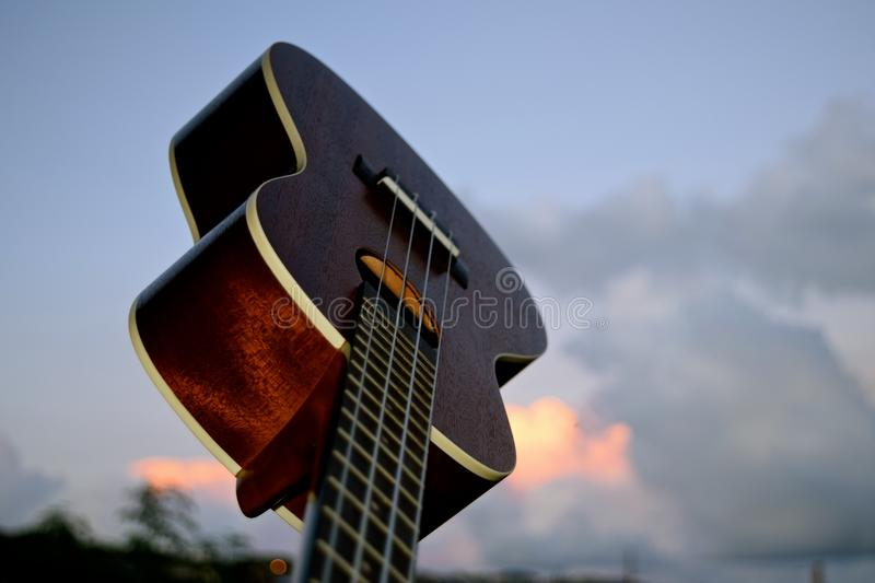 Ukulele Closeup. A small 4 stringed musical instrument that was popularized when it was introduced to Hawaii royalty free stock image